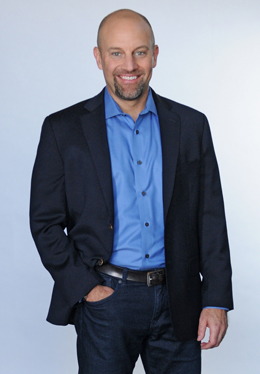 Small-Res-Mike standing - blue shirt, blue jacket - high res